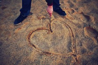 Man-beach-love-sand-medium